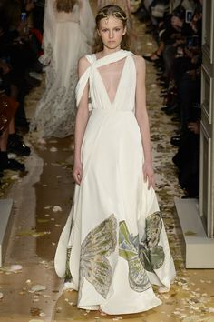 Valentino | Spring 2016 Couture | 25 White maxi dress with asymmetrical shoulders and butterflies at the hem