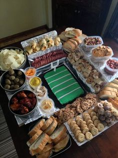 Snackadiums - Football Party Food pinned from yahoo article. Instead of using guac. for the field Nick of Dude Foods baked a Phillsbury cake mixed with crushed cookies & covered with green icing. Just got an idea to do mini mufffns or cupcakes iced & put them all together as the field.