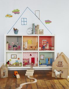 DIY Bookcase Dollhouse. This lovely, simple and practical doll house was created using Kallax or formerly Expedit shelving units. Using colorful wallpaper for the background of each square.  Check out the full tutorial