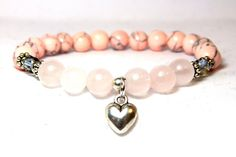 Soft and subtle rose quartz creates the perfect feminine gemstone bracelet. This pretty pink bracelet is made with 8mm Rose Quartz and Pink Magnesite with beautiful high quality crystals to compliment