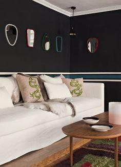 Black walls and white sofa