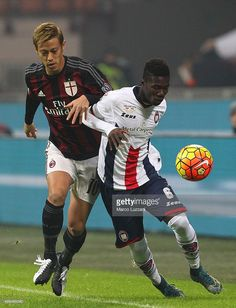 Eloge Koffi Guy Yao (R) of FC Crotone competes for the ball with Keisuke Honda (L) of AC Milan during the TIM Cup match between AC Milan and FC Crotone at Stadio Giuseppe Meazza on December 1, 2015 in Milan, Italy.