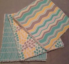 Three burp cloths in aqua, yellow and grey designer prints backed with chenille. These match the Little Ark blanket.