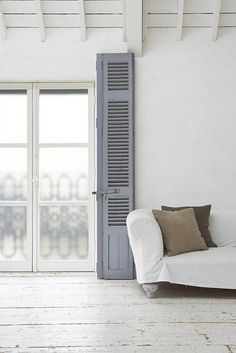 white walls, blue shutters, French doors, wood floor