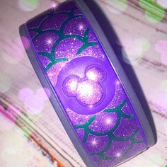 This is perfect for your ARIEL MERMAID lover!!! ✨✨  This listing comes with: 1 set of Purple and Green Glitter scales magic band wraps (one for each side) 1-purple glitter Mickey icon decal  If you would like to change the colors please let me know in check out. :)  Thanks so much, Taylor xox