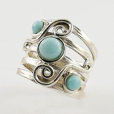 """Larimar Three Tone Sterling Silver Size 8 Ring. DETAILS: * Larimar Ring * Size 7 * 6.2 g total weight * Sterling Silver * Measures approximately 1/2"""" wide and 1"""" Beautiful Larimar sky blue stones are"""
