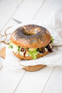 A vegetarian bagel sandwich (goat cheese, mixed greens, sun dried tomatoes, avocado, spring onions, pepper, and honey)...yum!
