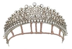 LATE 19TH CENTURY DIAMOND TIARA  Designed as a series of graduated old-cut diamond fan shaped motifs, interspersed with similarly-set lozenge panels, with foliate and scroll detailing and diamond single-stone finials, raised on an old-cut diamond square collet line border, mounted in silver and gold, circa 1890.  Image: Christies