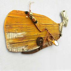 ScoobaFish, founded by Maurizio Sergiusti, created a stunning collection of Wall Sculptures made out of dumped and washed up objects. Wood Fish, Metal Fish, Paper Mache Sculpture, Wall Sculptures, Fish Model, Whale Tattoos, Driftwood Projects, Rock And Pebbles, Fish Design