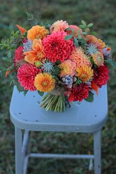 Autumn bridal bouquet with persimmon and orange dahlias, air plants, and succulents.  Grown and designed by Love 'n Fresh Flowers.