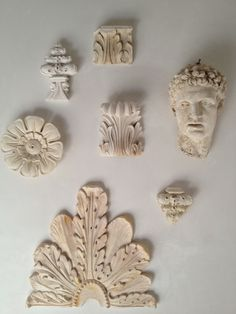 Giannetti Home: Patina Farm Giannetti Studio plaster pieces on our Living Room wall.