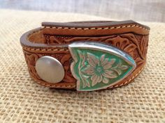 www.etsy.com/shop/journeyondesigns Leather cuff bracelet, handmade from recycled belts, hand-tooled, silver and teal