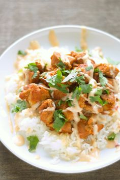 Crockpot Honey Sriracha Chicken (maybe make some substitutions or omissions to keep this healthy, and serve with a small portion of rice or spaghetti squash).