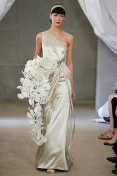 A large bouquet of cascading orchids at Carolina Herrera, Spring 2013 bridal market show