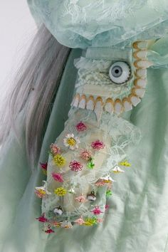 Detail of Jun Takahashi 'Alice' dress Is that an eyeball button?   Cynthia Reccord