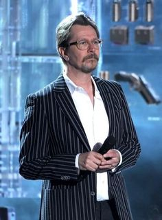 Gary Oldman Photos Photos - Actor Gary Oldman speaks onstage during the 2012 MTV Movie Awards held at Gibson Amphitheatre on June 2012 in Universal City, California. - 2012 MTV Movie Awards - Show Actor Gary Oldman, Tim Roth, Alec Baldwin, Universal City, Mel Gibson, Mtv Movie Awards, Christopher Nolan, Christian Bale, Daniel Radcliffe