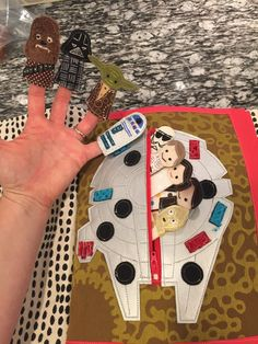 star wars quiet book. millenium falcon with finger puppets inside