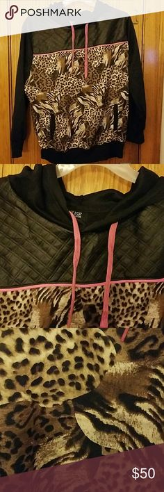 Cheetah shiny look pull over Great pull over cheetah print and black faux leather looking nylon sweater. A great fashionable comfy sweater. Its a 3x labeled but i feel it fits more for an xl or 2x! Rouge Collection Sweaters