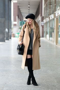 Max Mara Manuela camel coat, classic camel coat outfit, mini skirt with oversized sweater and thigh high boots, Stuart Weitzman black Highland boots with skirt