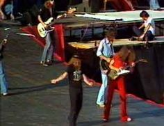 """Knebworth   Ronnie leads the boys out onto the Stones' """"tongue"""" despite instructions not to. Ha!"""