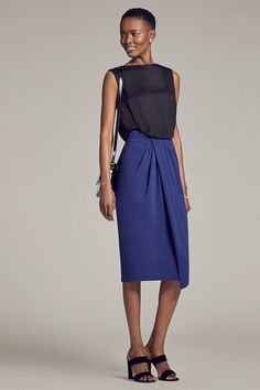 The easy appeal of this silk georgette skirt lies in its meticulous draping—the wrapped silhouette looks organic, but the angled folds are a genuine feat of engineering.