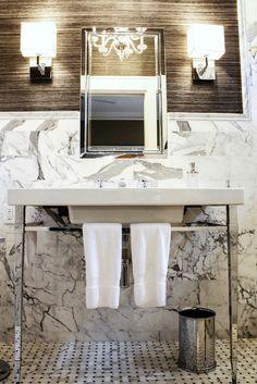 Retro vanity & fixtures .. Love how the Chrome fixtures set off the marble.