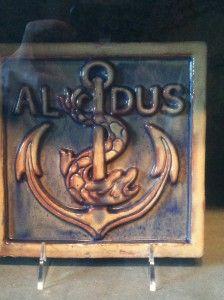 Tile of Aldus Manutius printer mark from the Moravian Tile Works in #Doylestown, PA.  #books #printing #tiles