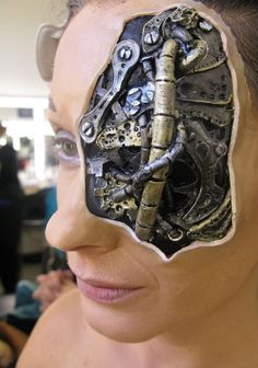 Steampunk Makeup Guide: Special FX Makeup using a prosthetic to create torn skin revealing a robot skeleton - For costume tutorials, clothing guide, fashion inspiration photo gallery, calendar of Steampunk events, & more, visit SteampunkFashionGuide.com