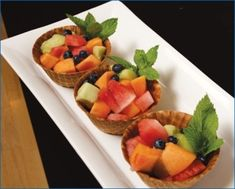 Fruit in a waffle cup. Cute idea! Might be easier than cones.