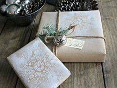 """Kraft paper, stencilled snowflake and twine with a """"tarnished"""" silver bell ... :: TWO IDEAS here: 1) Stencil in negative space on paper bag 2) Greenery w/Bell"""
