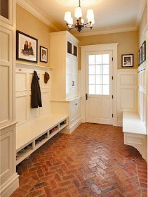 Marrvi mudroom! Paneled wainscotting, benches with shoe cubbies, storage closets and brick floors. #Home #Design #Remodel
