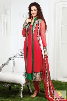 The fine green and red net santoon georgette party wear salwar suit is made up of nice jari lace patti work,embroidery work and stone work which appears chic.