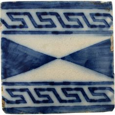 A single piece of azulejo, salvaged from a ceramic panel dating to the early 20th century in Portugal. The visible brushstrokes in deep blue give this tile its character. Measures: 14 cm x 14 cm (5.5""