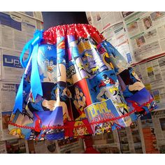 A Girl Power Super hero Womens skirt :) With red and white spots along the waist band and red ric rac along the hem. It is finished with an electric blue Satin…