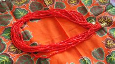 A personal favorite from my Etsy shop https://www.etsy.com/listing/466051950/red-hot-beaded-seven-multi-strand