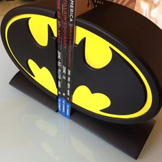 Display your Batman books, games, movies, and more with this stylish Batman logo bookend set! Hand painted in the Dark Knight's black and yellow, this limited edition bookend set measures approximatel