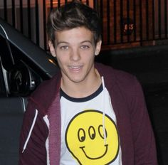Louis Tomlinson. They guy with a smiley face shirt with 3 eyes because he is special