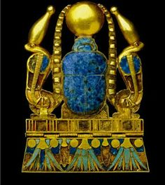 Set with a lapis lazuli scarab that supports the solar disk in motion, gold cloisonné pectoral, flanked by two serpents surmounted by the white crown comes from the funerary furnishings of King Sheshonq II at Tanis. It evokes the rebirth of the dead king in the form of a scarab. Cairo Museum, Egypt.