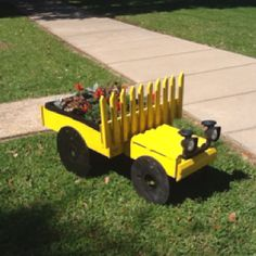 TRUCK PLANTER we created. It has beautiful flowers we enjoy during the day AND solar lights that shine during the night. We had a lot of fun creating this together!!!