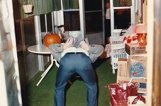Vintage Photograph Man Bending Over & Showing Butt Groceries & Pumpkin on Table