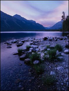 Picture: Lake McDonald at sunset with forest fire smoke, Glacier National Park, Montana