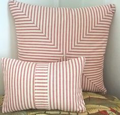 We overlayed the ticking to form a central band to create a point of interest on this small head rest cushion. Sits beautifully with the diagonally cut ticking stripe featured on the cushion cover behind.