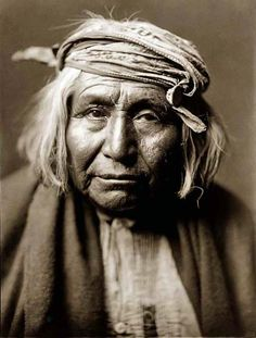 "Apache man, photo by Edward S. Curtis.  Despite the fact that Curtis staged some of his photos, says Laurie Lawler, ""Curtis respected the Indians he encountered and was willing to learn about their culture, religion and way of life. In return the Indians respected and trusted him. When judged by the standards of his time, Curtis was far ahead of his contemporaries in sensitivity, tolerance, and openness to Native American cultures and ways of thinking."""