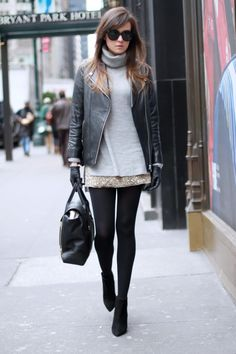 Ultra-short shimmery skirt/dress + long turtleneck sweater + leather biker jacket + black opaque tights