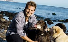 Celebrity Bradley Charles Cooper on the Beach with the Dogs