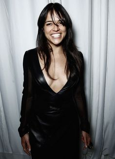Celebrities In Leather: Michelle Rodriguez wears a black dress with leathe...