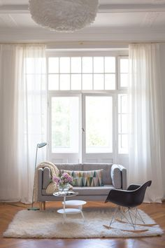 Beautiful, wide windows, with sheer curtains