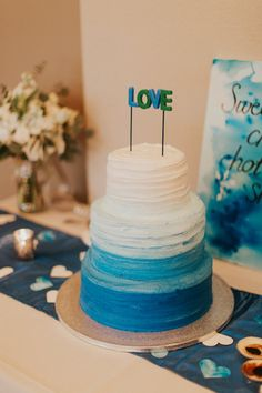 "Handmade cake topper for a wedding themed ""You Color My World."" Created by Christina Gates: www.createdbychrista.com/weddings. Photo Credit: Sarah & Paul Photography. #createdbychrista #wedding #youcolormyworld #blue #white #silver #color #colorful #cake #ombre #art #watercolor #painterly #painting #canvas #modern #timeless #handmade #handcrafted #original #custom #personalize #design #event #specialoccasion #theme #art #artwork #creative #unique #love #caketopper"