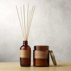 Teakwood and Tobacco Reed Diffuser. An intriguing mix of sultry and masculine, this aromatic fragrance oil is hand-blended and hand-poured in small batches by artisans at P. in Southern California. Hygge, Best Diffuser, Limpieza Natural, Amber Glass Jars, Popular Perfumes, Patchouli Essential Oil, Soy Wax Candles, Scented Candles, Aesthetic Iphone Wallpaper