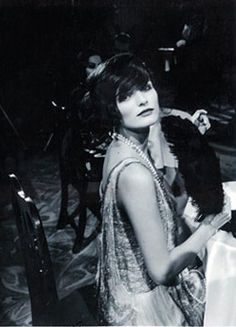 "Coco Chanel in a Paris nightclub, 1923. She had picked up the nickname Coco while singing in local nightclubs aged 18, where her favourite song was about a missing dog called ""Who's Seen Coco In The Trocadero?"". It stayed with her forever."